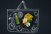 Healthy lunch. Chalk drawn sketch shopping bag with dinner meal and smoothie, top view