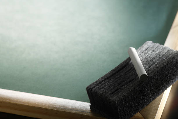 Chalk & Eraser on Blackboard stock photo