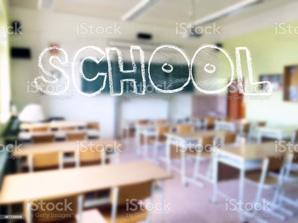 Chalk lettering with a blurred classroom stock photo