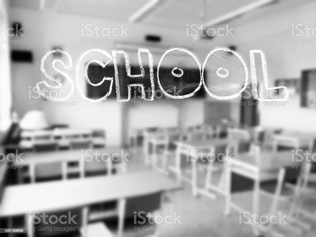 Chalk lettering with school classroom in the background stock photo