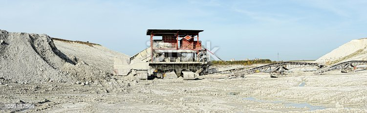 chalk mine with stone crusher and conveyor belt. mining industry. panorama made of 4 separate images.