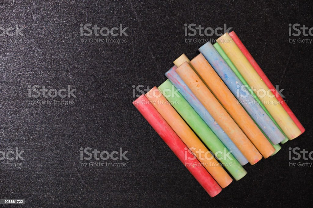 Chalk rubbed out on blackboard for background. Empty blank black chalkboard with colorful chalk stock photo