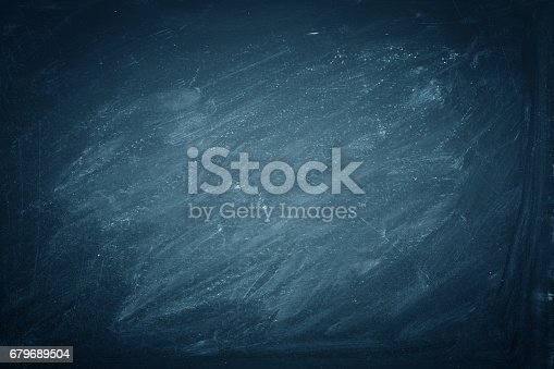 istock Chalk rubbed out on blue blackboard background, texture 679689504