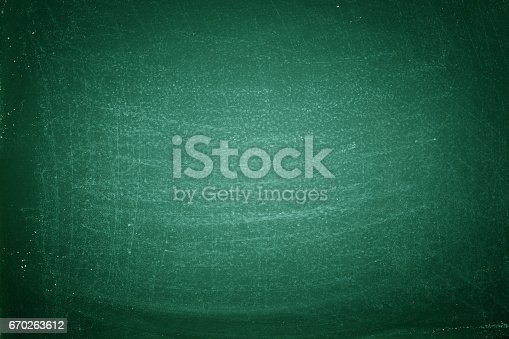 istock Chalk rubbed out on green blackboard background, texture for design. 670263612