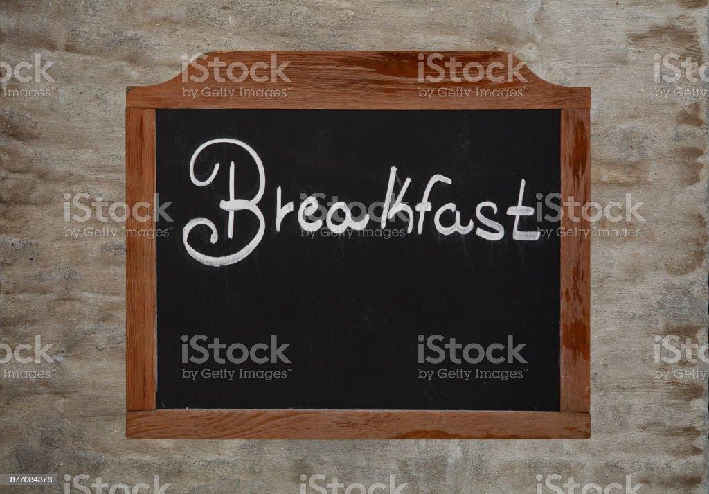Chalk word breakfast on vintage blackboard on wall stock photo