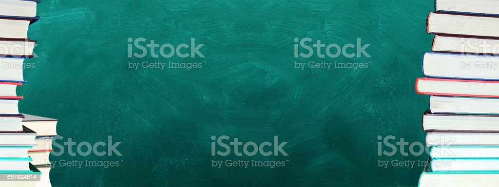 Chalkboard and books stock photo