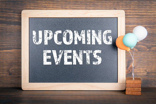 UPCOMING EVENTS. Chalkboard and colored balloons on a wooden background.