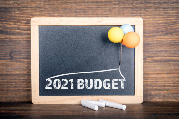 2021 BUDGET. Chalkboard and colored balloons stock photo
