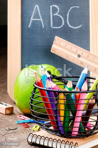 istock Chalkboard and colorful crayons 177410247