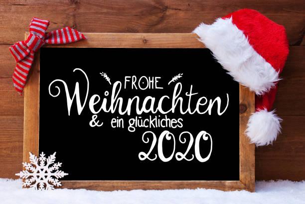 Tafel, Weihnachtsdekoration, Weihnachtsmann Hut, Glueckliches 2020 bedeutet glücklich 2020 – Foto