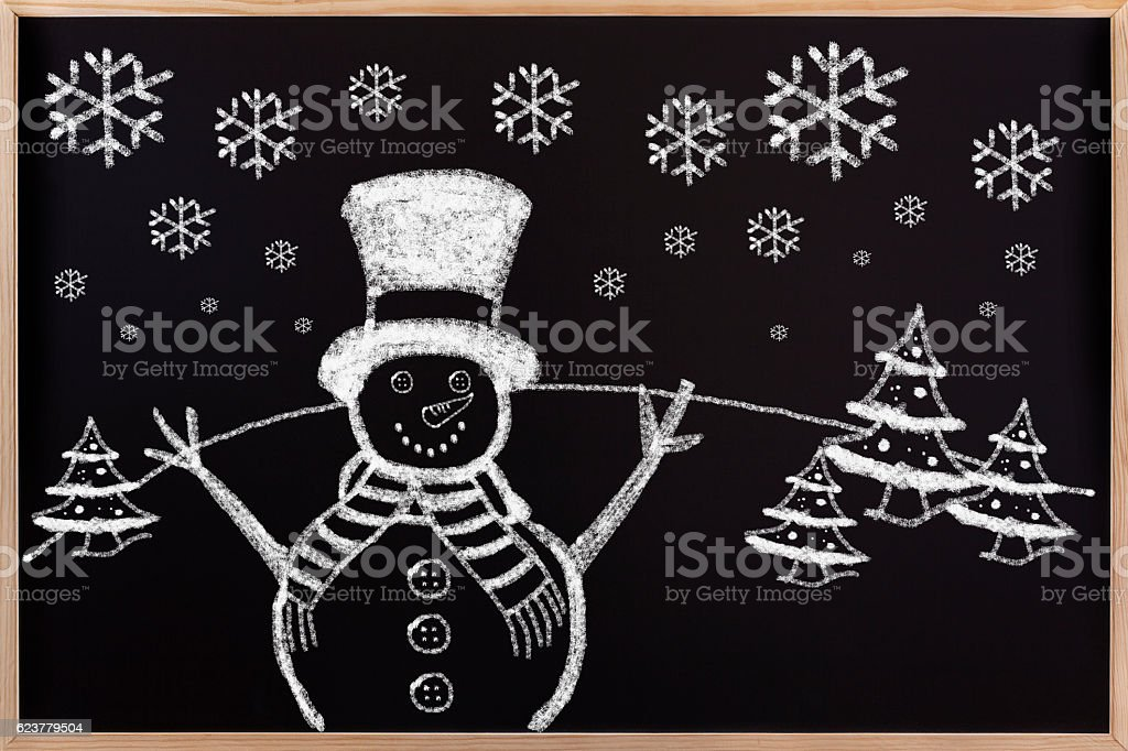 Chalkboard drawing of cute Christmas snowman in the wooden. stock photo