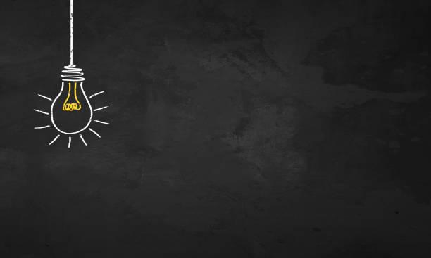 chalkboard light bulb - idea foto e immagini stock