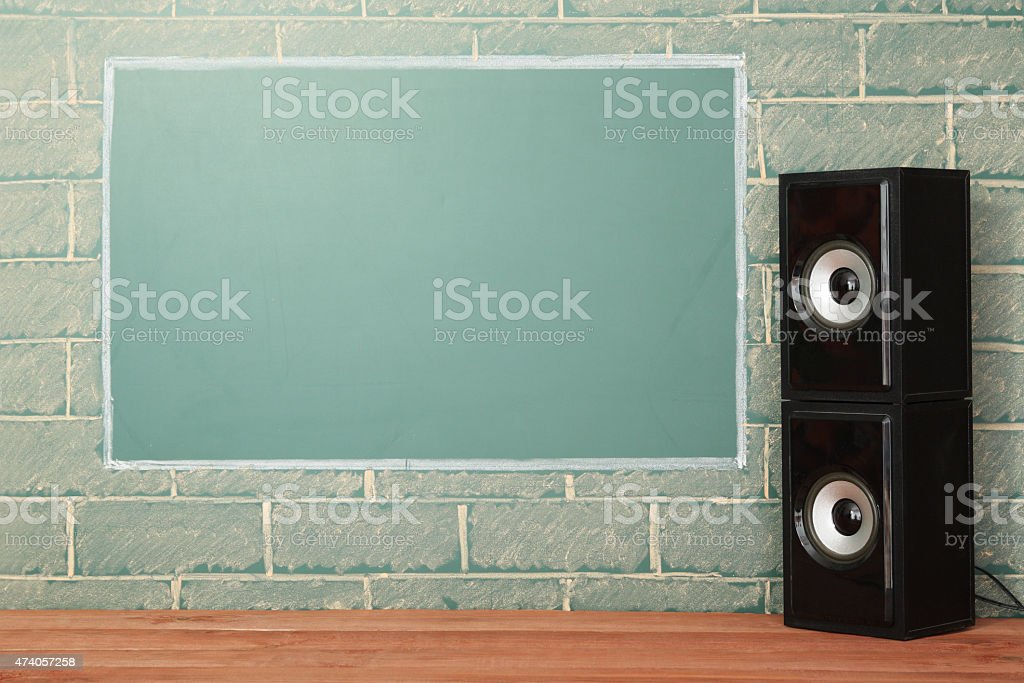 Chalkboard next to base speakers stock photo