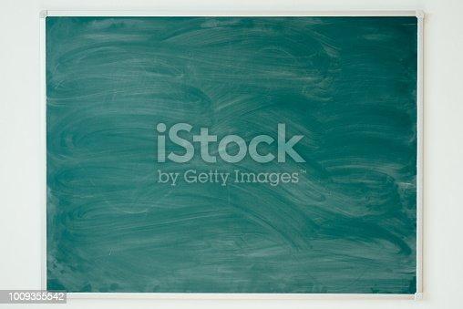 istock Chalkboard texture in classroom school or college Blackboard background. 1009355542