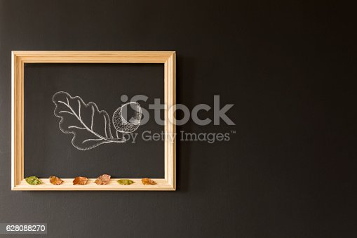 istock Chalkboard wall with acorn drawing 628088270