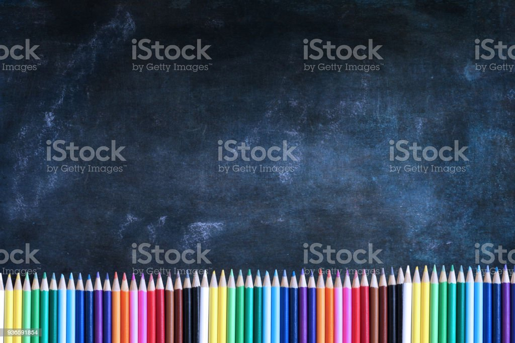 Chalkboard with Colored Pencils stock photo