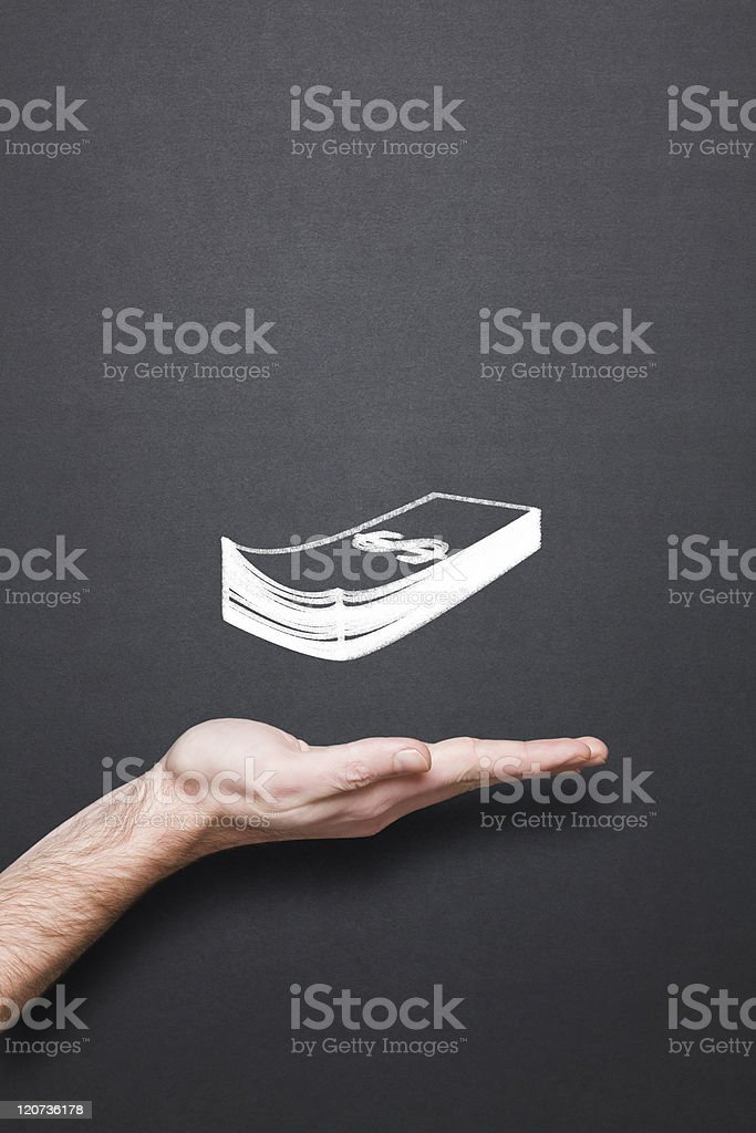 chalkboard with hand and money wad royalty-free stock photo