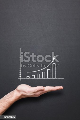 istock chalkboard with hand and trend chart 119970339