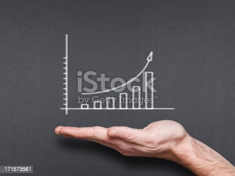 istock chalkboard with hand and trend chart 171573561
