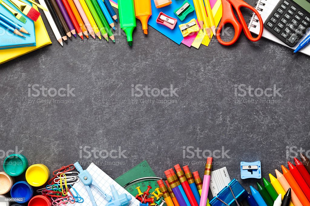 Chalkboard with school supplies at the bottom and top borders stock photo