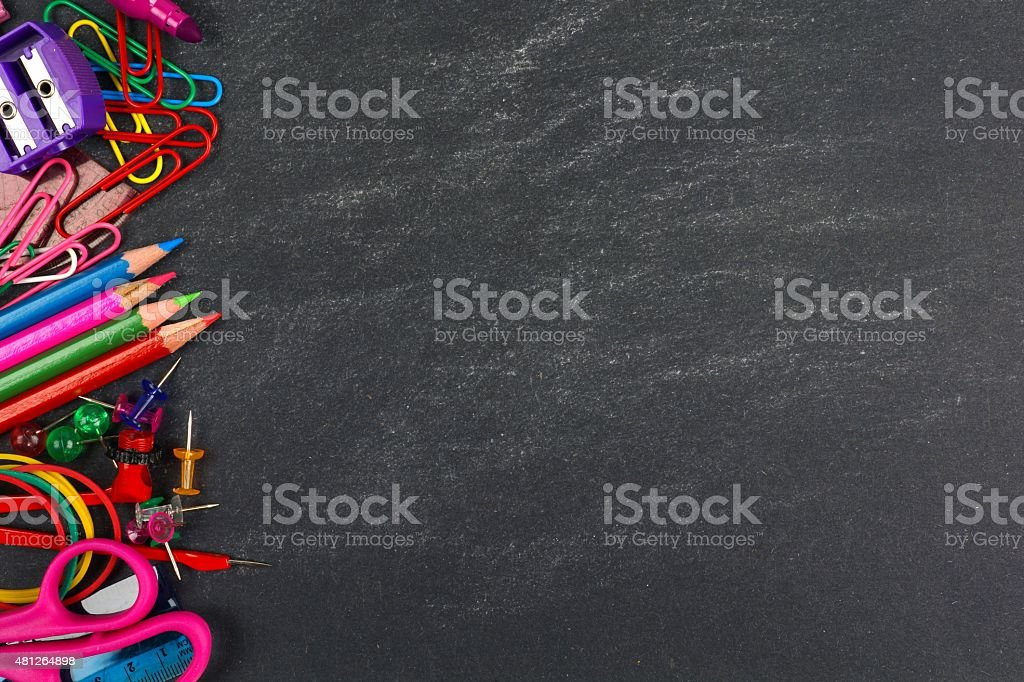 Chalkboard with school supplies side border stock photo