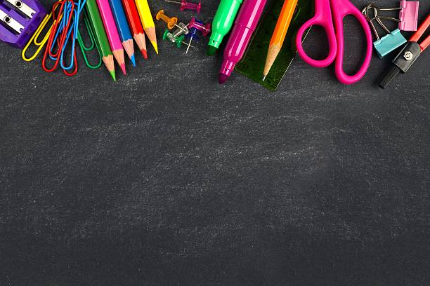 Chalkboard with school supplies top border School supplies top border on a chalkboard background school supplies border stock pictures, royalty-free photos & images