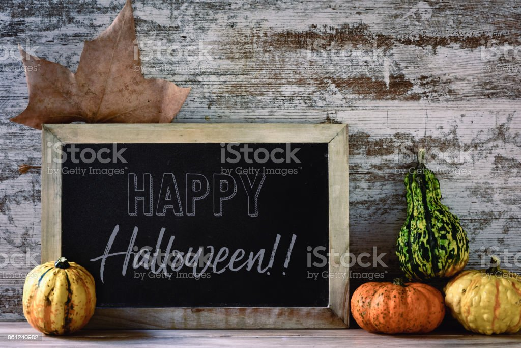 chalkboard with text happy halloween and pumpkins royalty-free stock photo