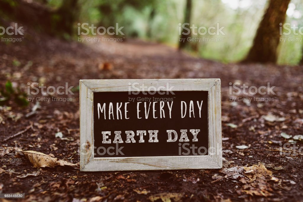 chalkboard with the text make every day earth day stock photo