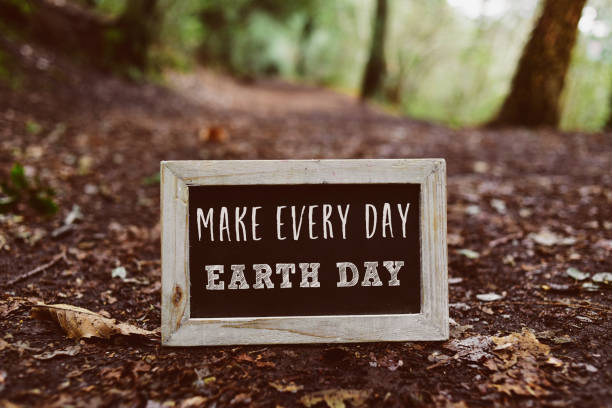 chalkboard with the text make every day earth day closeup of a wooden-framed chalkboard with the text make every day earth day written in it, on the ground in the woods earth day stock pictures, royalty-free photos & images