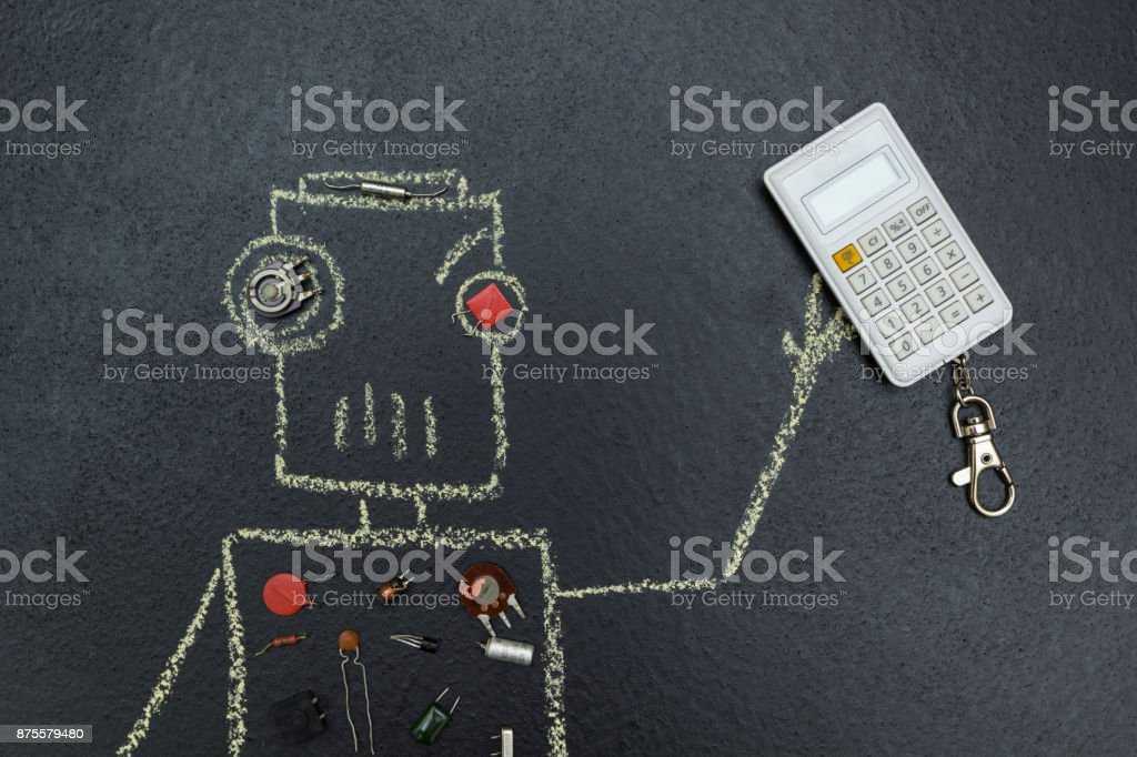 A chalk-drawn robot and retro radio parts. Holds a calculator in his hand. stock photo