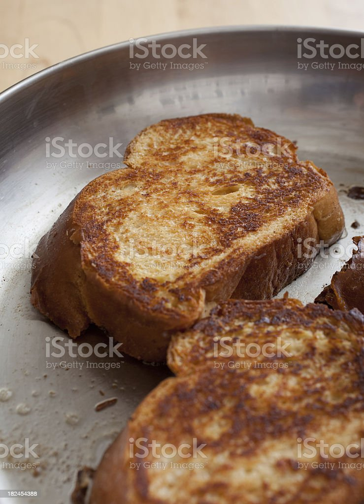 Challah French Toast Cooking in the Pan royalty-free stock photo