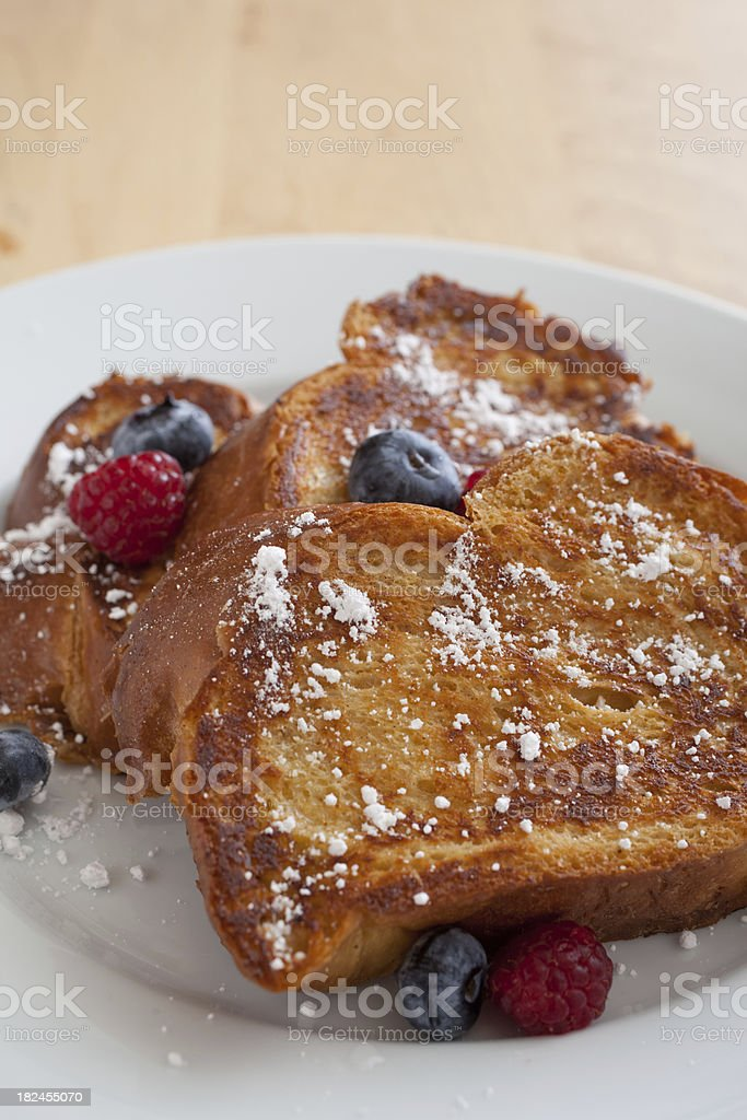 Challah French Toast with Blueberries and Raspberries royalty-free stock photo