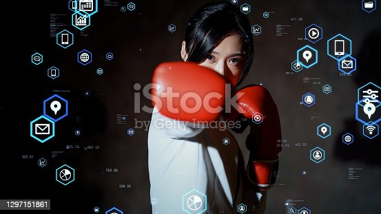 Challenge of business concept. Power of business. Asian woman punching with boxing gloves.
