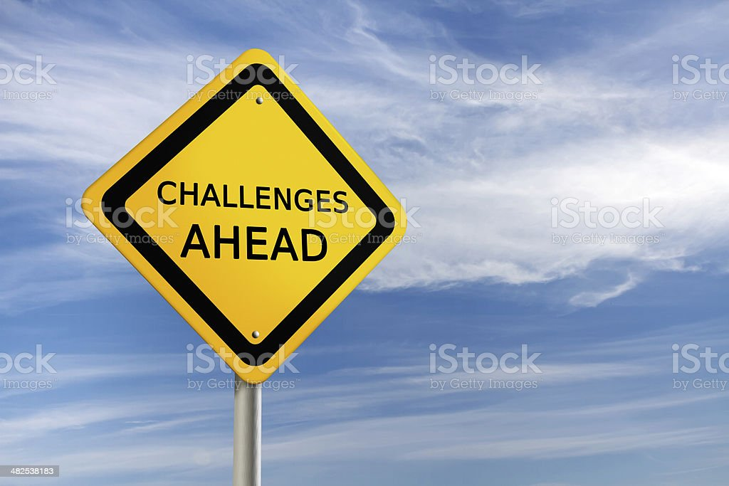 Challenges ahead road sign stock photo