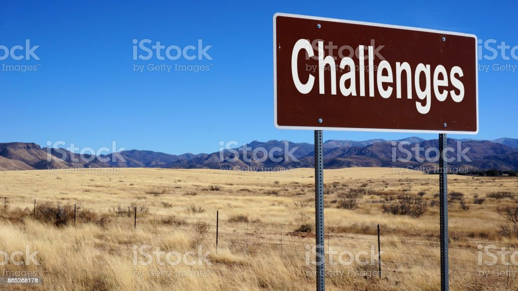 Challenges road sign stock photo