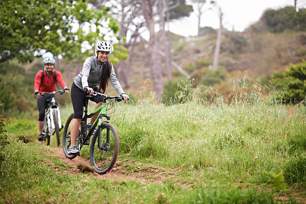 challenging each other - mountain biking stock photos and pictures