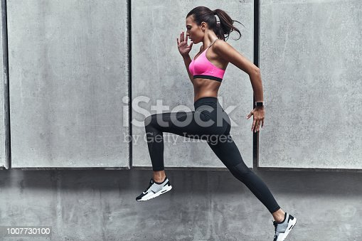 istock Challenging herself. 1007730100