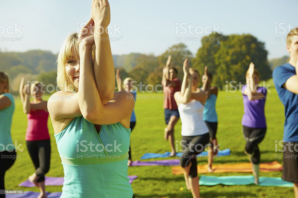 Challenging the class with new poses - Yoga stock photo