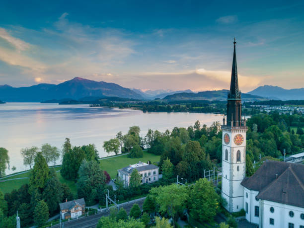 Cham Church Cham church with the last of the day's sun touching the top of Mount Rigi in the background zug stock pictures, royalty-free photos & images