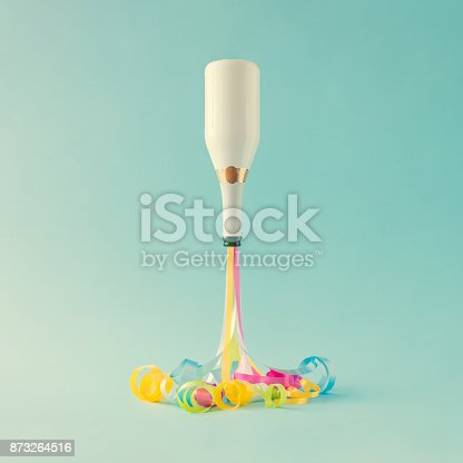 istock Chamagne bottle with party streamers. Party minimal concept. New Year countdown. 873264516