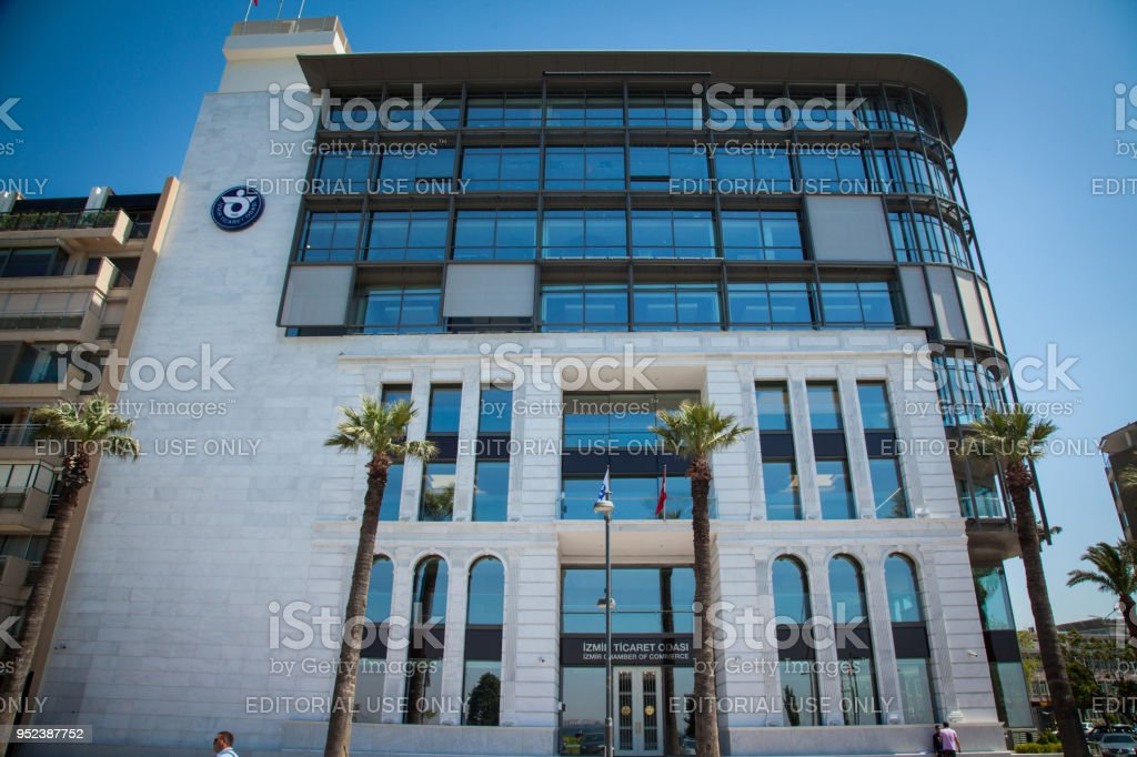 Chamber of commerce new building on izmir kordon avenue with people...