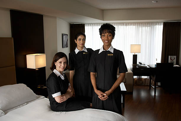 chambermaids in hotel room, portrait - maid stock pictures, royalty-free photos & images