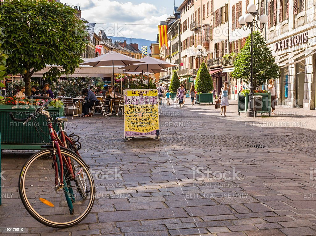 Chambéry (France). Place Saint Léger with bycicle, tourists and stores stock photo