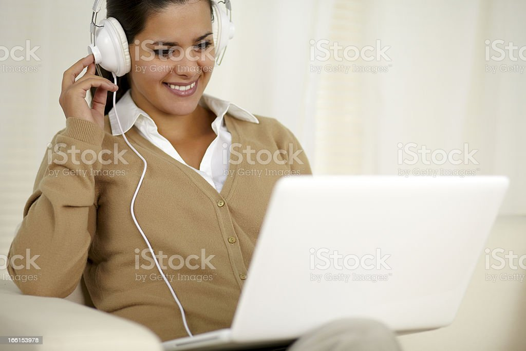 Chaming young woman with headphone listening music royalty-free stock photo