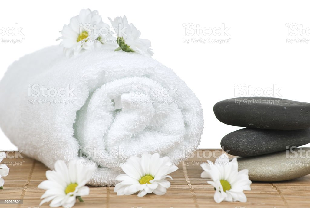Chamomile flowers and massage stones royalty-free stock photo