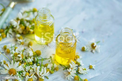 istock Chamomile oil ,  chamomile essential oil bottles with chamomile flowers 1189300370