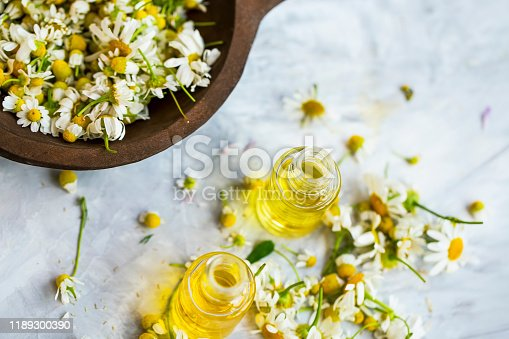 istock Chamomile oil ,  chamomile essential oil bottles with chamomile flowers 1189300390