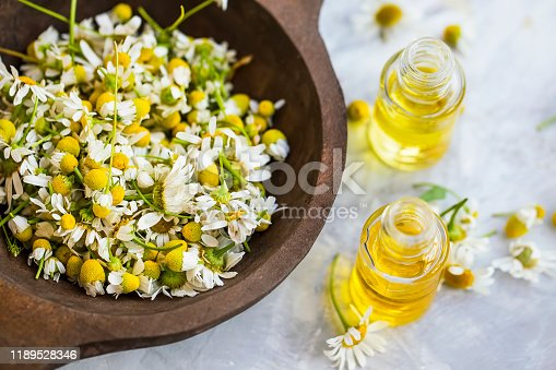 istock Chamomile oil ,  chamomile essential oil bottles with chamomile flowers 1189528346