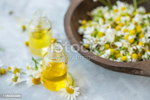 istock Chamomile oil , floral chamomile essential oil bottles with chamomile flowers 1189300389