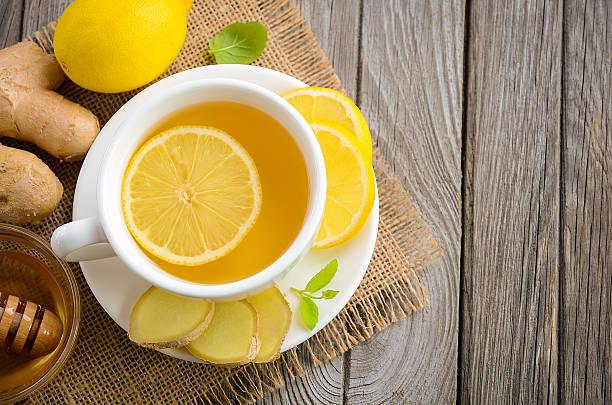 Chamomile tea with lemon, ginger and honey stock photo